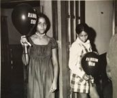 Girls Holding Rainbow Sign balloons