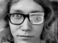 Young Man with Drawing on Glasses